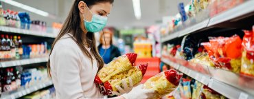Coronavirus impact on ecommerce, sellers & buyers: woman shopping in a supermarket